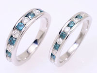 Colored diamonds, channel set, a unique blue and white diamond ring.