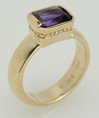 Amethyst and white gold promise ring.
