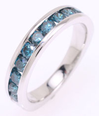 Diamond ring, channel set with unique blue diamonds.