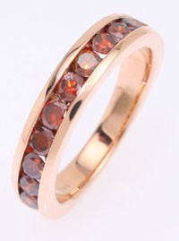 Diamond that are cognac color set in a rose gold ring.