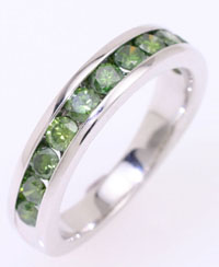 Diamonds channel set with unique green diamonds in a ring.