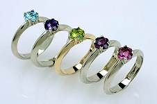 Promise rings, in white gold and yellow gold, with unique gemstones, unique rings