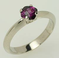 Garnet and white gold promise ring.