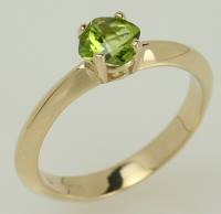 Peridot and yellow gold promise ring.