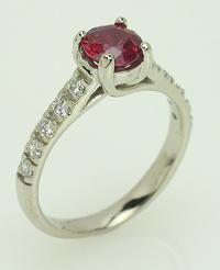 Righteous round ruby with diamond accents set in 14kt white gold.