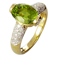 Unique Peridot and Diamond Ring set in gold.