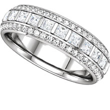 A unique design princess cut and round diamond and platinum eternity ring.