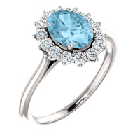 Unique aquamarine with a diamond halo in 14kt white gold gemstone ring.