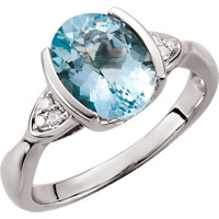 Captivating contemporary aquamarine gemstone ring with diamond accents.