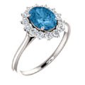 Gemstone rings, oval blue topaz,white diamond halo, white gold.