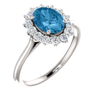 Pleasing blue topaz with diamond halo in white gold