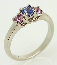 Pleasing round tanzanite and round pink sappphire gemstone ring set in 14kt white gold.