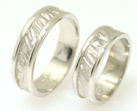 Unique wedding rings, sandblasted relief with high polish borders, yellow gold, white gold.