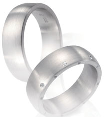 Wedding bands, white gold, dombed top satin finish random diamond accents.