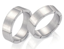 Unique wedding rings, white gold, flat sides and top engraved lines, satin finish.