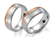 Unique wedding rings  partial  rose gold high polish, partial white gold satin finish.