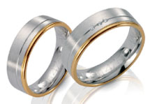 Wedding rings white gold and rose gold accent satin finish diamond accents.