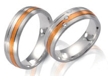 Unique wedding rings, white gold inlayed, rose gold diamond accents.