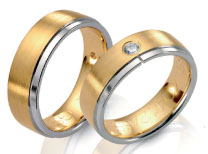 Wedding bands in yellow gold satin finish with high polish white gold edge, diamonds.