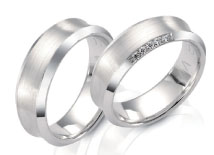 Wedding rings, white gold, concave top, satin beveled side, high polish.