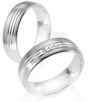 Wedding bands  white gold high polish and satin finish diamond accents.