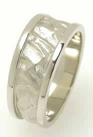 Unique wedding bands, platinum, sandblasted high relief with high polish borders.