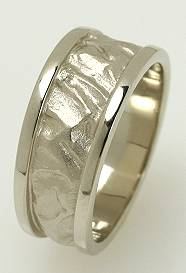 Platinum ring with sandswept pattern.