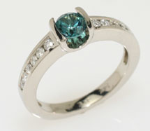 Gorgeous round green tourmaline ring, diamond accents down the side 14kt white gold.